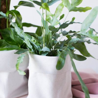DIY Canvas Fabric Planter Covers made from Plastic Bottles